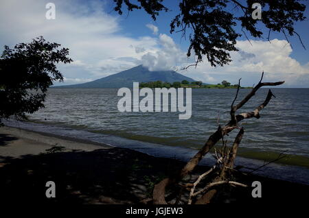 A view of Volcan Maderas from the black volcanic sand beach of Isla Ometepe - Stock Photo