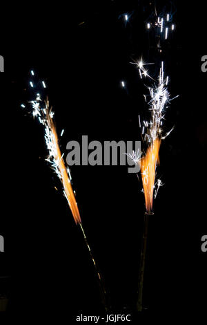 Fireworks on a black background in different shapes - Stock Photo