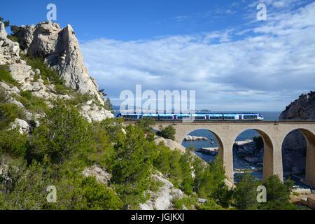 Local or Regional Train Crossing Railway Viaduct at La Vesse Calanque on the Mediterranean La Côte Bleue or Blue - Stock Photo