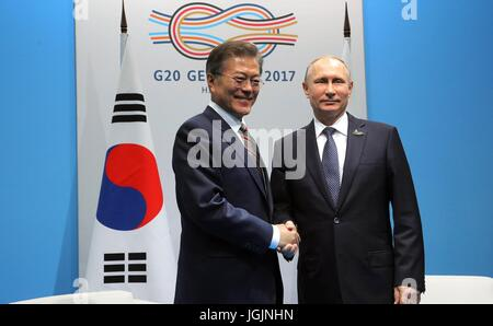 Russian President Vladimir Putin shakes hands with South Korean President Moon Jae-in before the start of their - Stock Photo