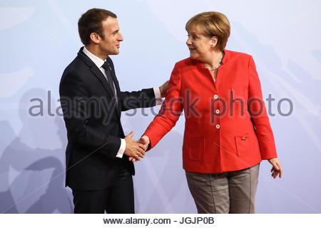 Hamburg, Germany. 7th Jul, 2017. Emmanuel Macron, president of France welcomes by German chancellor Angela Merkel - Stock Photo