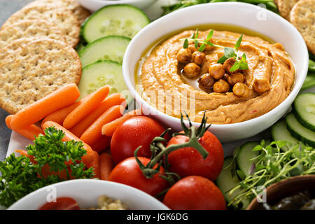 Hummus and vegetables platter with grain salad - Stock Photo