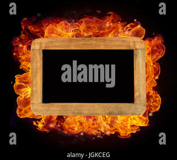 Old wooden small chartboard in fire with free space for text - Stock Photo
