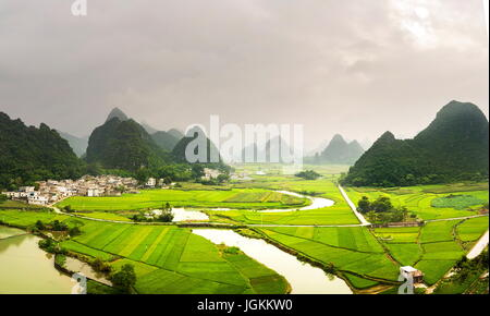 Stunning rice field view with karst formations in Guangxi, China - Stock Photo