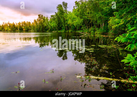 Small lake in Michigan's Upper Peninsula at sunset - Stock Photo