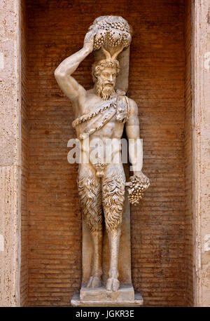 Statue of a Satyr in a courtyard of the Palazzo Nuovo, Capitoline Museums, Rome, Italy. - Stock Photo