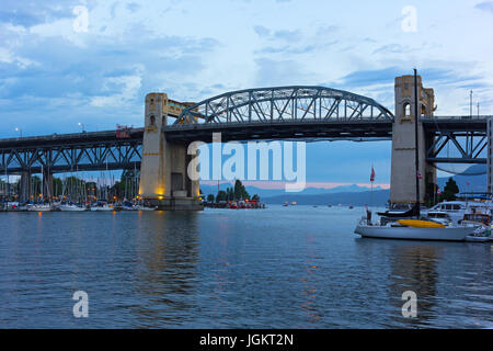 Burrard Bridge at dawn in Vancouver, British Columbia, Canada. Steel truss bridge over False Creek with imposing - Stock Photo