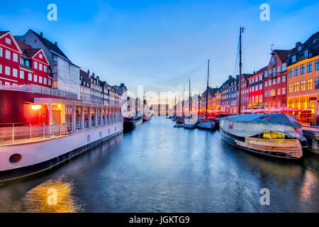 Nyhavn with colorful facades of old houses in Copenhagen, Denmark - Stock Photo