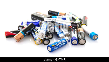 SWINDON, UK - JULY 9, 2017: Collection of assorted batteries ready for recycling on a white background - Stock Photo