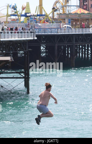 As the temperatures soar in Brighton East Sussex some take their life in their own hands. - Stock Photo