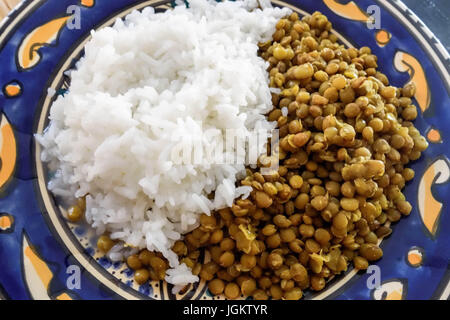 Middle Eastern Cuisine. Lentils and Rice. In Syria, it is called mudardara, In Egypt , megadarra. - Stock Photo