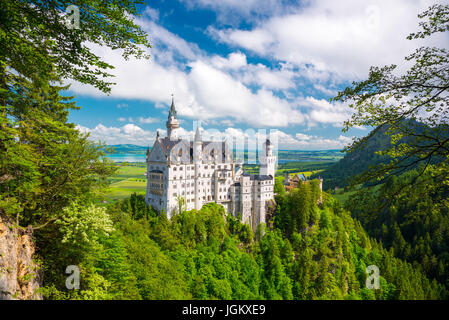 Medieval castle Neuschwanstein. Around the blue sky and the Alps. Beautiful view of the castle. Open landmark and - Stock Photo
