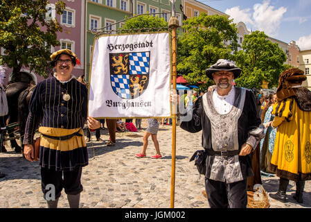 Burghausen,Germany-July 08,2017: Actors dressed in medieval costumes diplayat the banner of the city at the beginning - Stock Photo