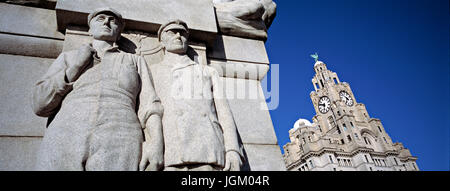 Detail of Titanic Memorial, Liverpool, with Royal Liver Building in the background. The sculpture, by Sir William - Stock Photo