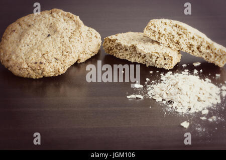 Homemade oatmeal cookie, healthy dessert, on dark background. Toned photo. Copy space. Selective focus - Stock Photo