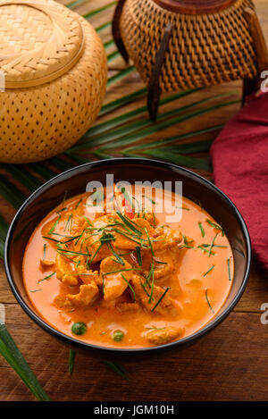 Chicken in curry sauce in a pan with the ingredients on the old desk,adjustment size for banner,cover and header. - Stock Photo