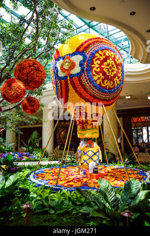 Las Vegas, USA - May 7, 2014: Wynn hotel decorated with rose flowers and hot air balloon inside mall in Nevada - Stock Photo