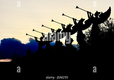 Las Vegas, USA - May 7, 2014: Silhouettes of angels blowing trumpets in Nevada city during sunset by Caesars Palace - Stock Photo