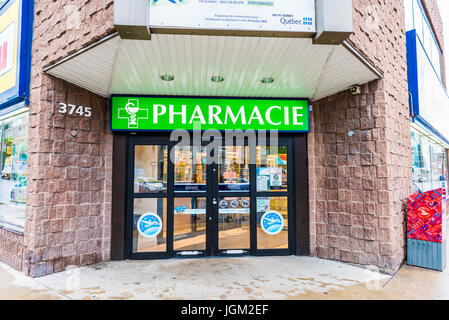Montreal, Canada - May 26, 2017: Pharmacie store entrance and sign pharmacy in downtown city during daytime - Stock Photo