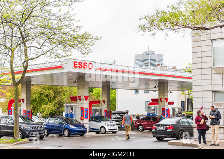 Montreal, Canada - May 26, 2017: Esso gas station in downtown for car fuel with prices and people - Stock Photo