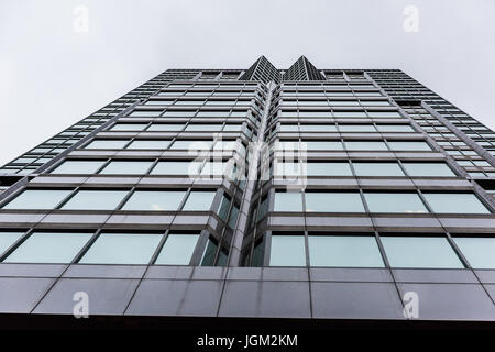 Montreal, Canada - May 26, 2017: Modern glass building skyscraper with windows in downtown area in Quebec region - Stock Photo