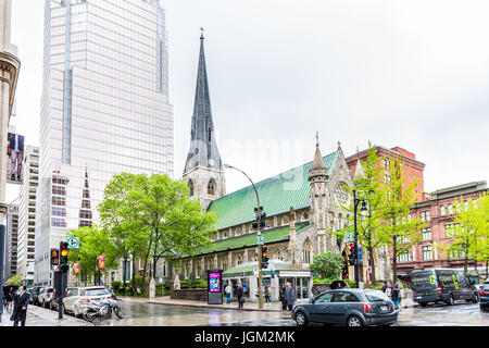 Montreal, Canada - May 26, 2017: Christ Church Cathedral and Promenades de la Cathedrale with KPMG building in downtown - Stock Photo
