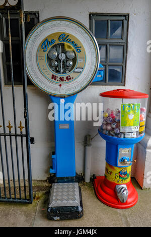 Penarth, Wales - May 21, 2017: WSG coin operated weighing machine on Penarth Pier, standing by the wall. - Stock Photo