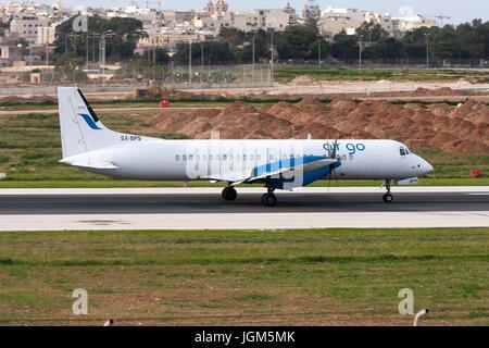 Luqa, Malta December 13, 2010: AirGo Airlines British Aerospace ATP(F) [SX-BPS] landing runway 31. - Stock Photo