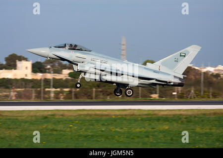 Luqa, Malta December 9, 2010: Royal Saudi Arabian Air Force Eurofighter Typhoon F2 landing runway 31 on delivery - Stock Photo