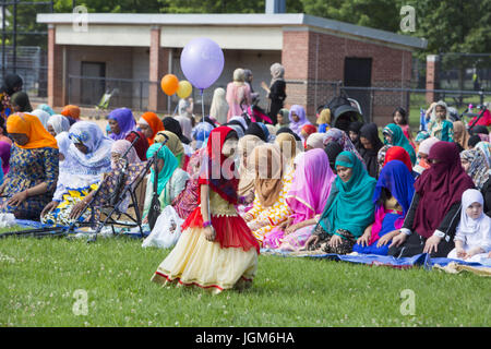 Muslims from various nations, immigrant groups, gather on Eid in Prospect Park, Brooklyn, NY to pray together. Eid - Stock Photo
