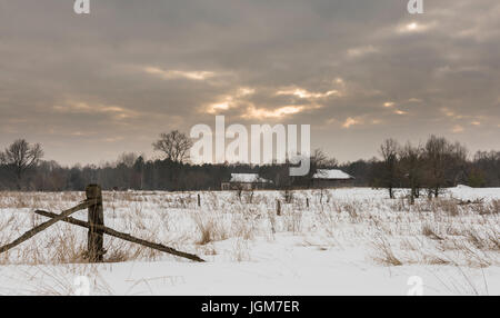 Radioactive winter landscape near Chernobyl with abandoned farms and houses in the death-zone in the Ukraine. - Stock Photo