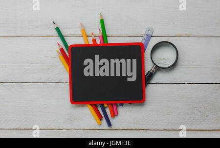 Top view Back to school or education background concept.the stationary with black board,colorful pencil,magnifier, - Stock Photo