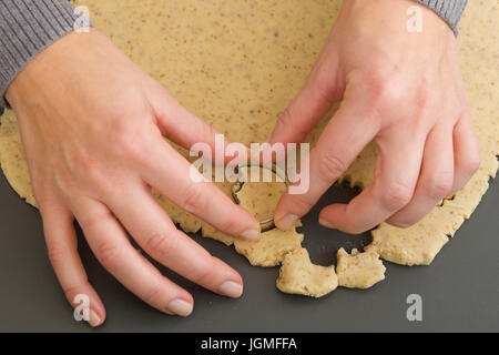 Biscuits dig up - Punching out biscuits, Kekse ausstechen - Punching out biscuits - Stock Photo