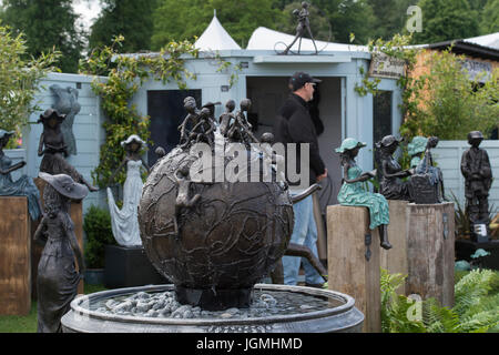 Close-up of original bronze water feature and garden statues on a trade stand - RHS Chatsworth Flower Show, Chatsworth - Stock Photo