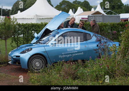 Riversimple 'Rasa' hydrogen powered eco car viewed by people in show garden - RHS Chatsworth Flower Show, Chatsworth - Stock Photo