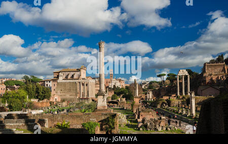 Tourists visit Roman Forum ancient ruins and Palatine Hill in the historic center of Rome - Stock Photo