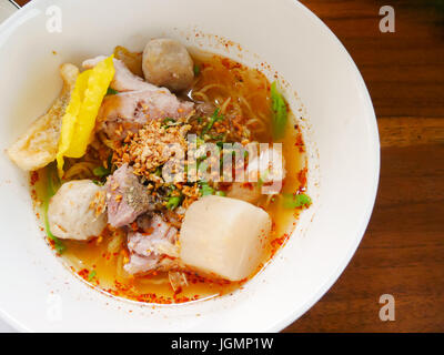 Close up thai spicy noodle and herb with copy space - Stock Photo
