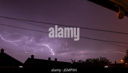 UK Weather. Thunder storm in the early hours of  morning with spectacular lightning above sleeping homes. Lound - Stock Photo