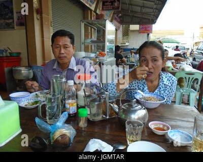 Supper meal in Poipet Cambodia Decrepit Impoverished Town on the Thailand Border Line - Stock Photo
