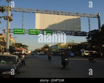 Highway Signs Road Markers Poipet Cambodia Decrepit Impoverished Town on the Thailand Border Line - Stock Photo