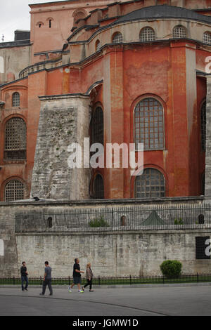 Spectators and tourists passing close to famous Hagia Sophia; Istanbul, Turkey; - Stock Photo