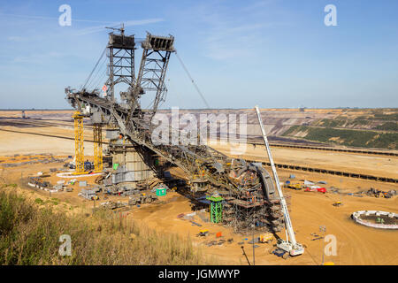 INDEN, GERMANY - JUNE 30, 2012: Construction of a large mining bucket-wheel excavator to dig for brown-coal in the - Stock Photo