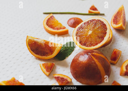 Juice of blood red oranges, freshly cut, fresh fruit - Stock Photo