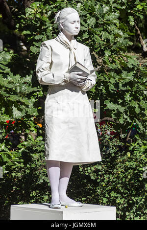 29.06.2017 ,Saint Petersburg , Russia .Mime painted in white color depicting a monument woman with a book ., summer - Stock Photo