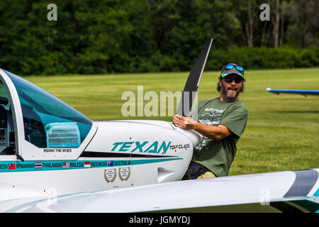 Man pulling the Texan top class touristic airplane to the runway. - Stock Photo