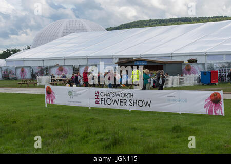 Showground at first RHS Chatsworth Flower Show (people having refreshments at café near floral marquee) Chatsworth - Stock Photo