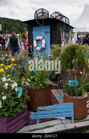Flowering plants & shed in beautiful display garden - Plant Village, RHS Chatsworth Flower Show showground, Chatsworth - Stock Photo