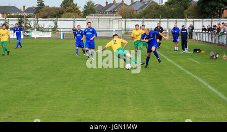 Local football match between Billingham and Stockton in north east England,UK - Stock Photo