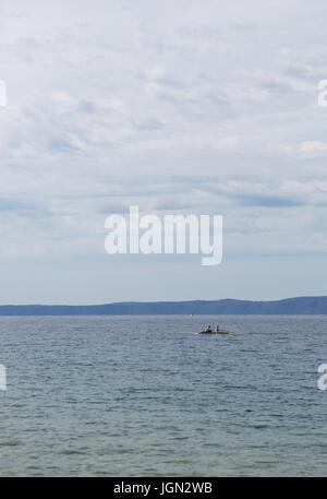 MAKARSKA,CROTIA - 16 JUNE,2017: Couple of young boys enjoy sailing in vessel boat at crystal clear Adriatic sea.Enjoy - Stock Photo