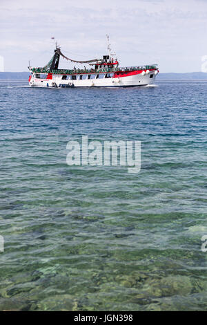 MAKARSKA,CROTIA - 16 JUNE,2017: Tourists enjoy sailing on sightseeing ship & go scuba diving in crystal clear deep - Stock Photo